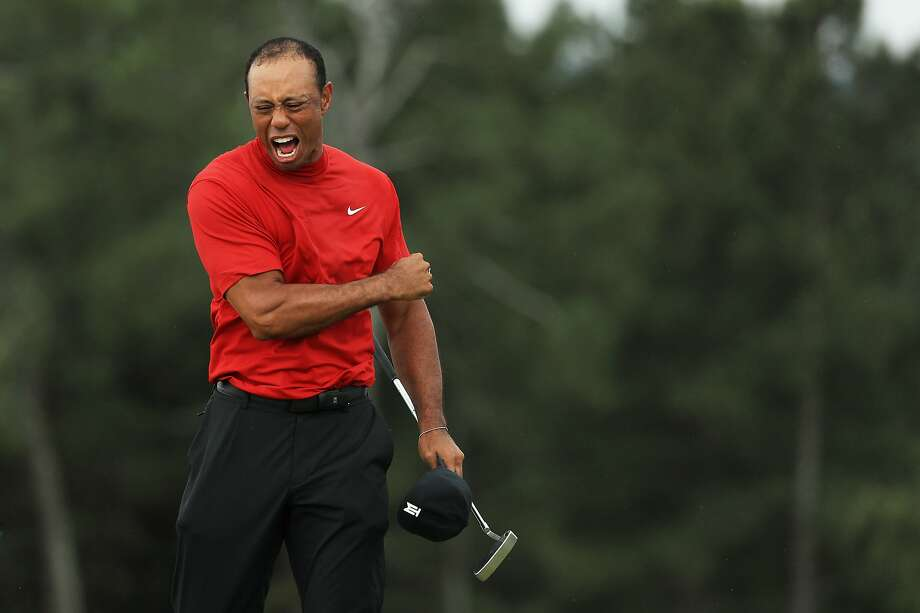 AUGUSTA, GEORGIA - APRIL 14: Tiger Woods of the United States celebrates after sinking his putt on the 18th green to win during the final round of the Masters at Augusta National Golf Club on April 14, 2019 in Augusta, Georgia. (Photo by Mike Ehrmann/Getty Images) Photo: Mike Ehrmann, Getty Images