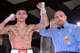 Boxer Michael Dutchover, a Midland High grad, is seen here after a recent win.