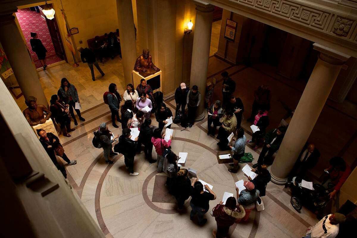 Protesters inside City Hall organize to attempt to meet the mayor and supervisors on Thursday, May 9, 2019, in San Francisco, Calif. Homeless mothers and their supporters rallied to demand the city for housing subsidies, navigation centers and shelter funding for homeless families.