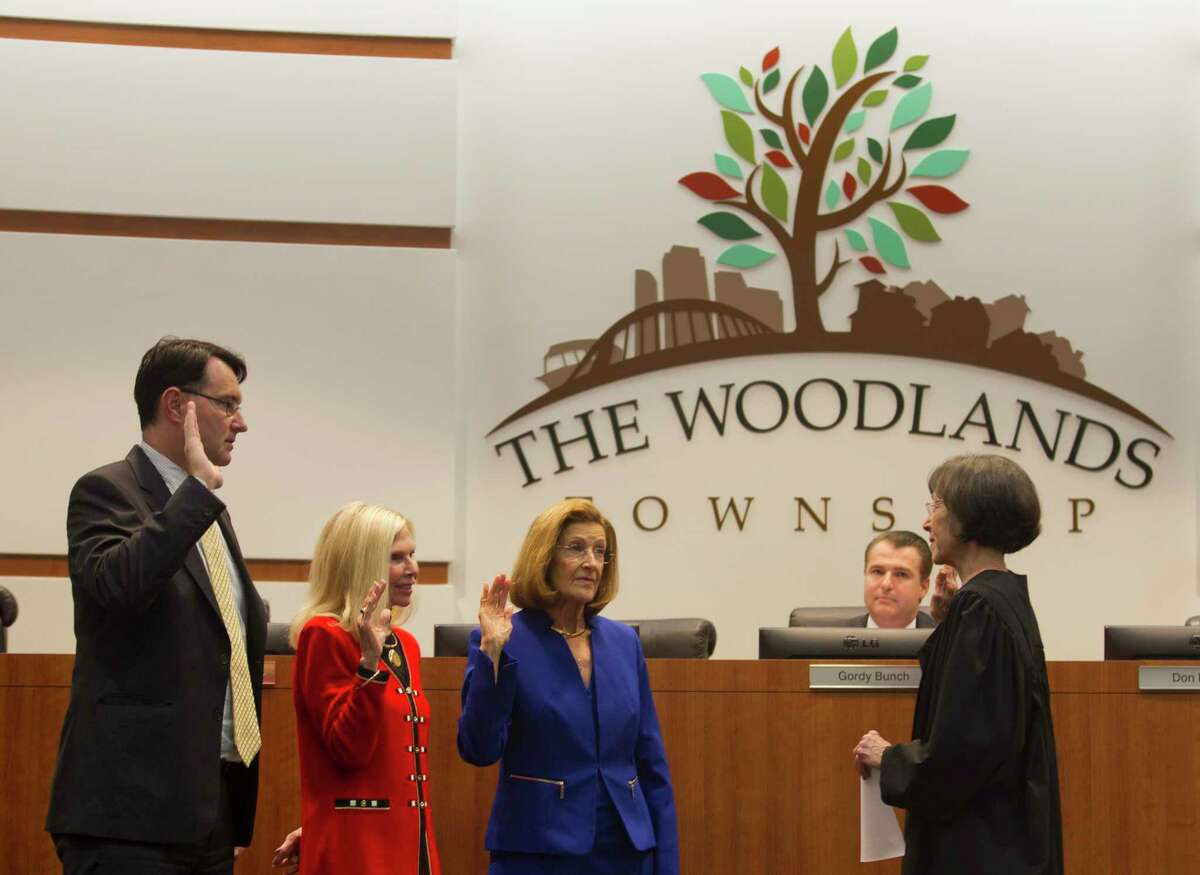 In this file photograph from 2017, newly elected board member Carol Stromatt, third from left, is sworn in beside Ann Snyder and John McMullan during a meeting of The Woodlands Township Board of Directors, Wednesday, Nov. 29, 2017, in The Woodlands. McMullan ran uncontested in 2017 for what would turn out to be his final two-year term on the seven-member board.