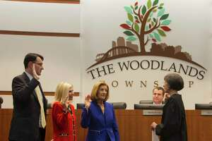 This 2017 photograph shows newly elected board member Carol Stromatt, third from left, being sworn into office with fellow directors Ann Snyder and John McMullan during a meeting of The Woodlands Township Board of Directors, Wednesday, Nov. 29, 2017, in The Woodlands. This year, both Stromatt and McMullan have announced they are not seeking re-election in the Tuesday, Nov. 5, election. The filing period for candidates begins July 20 and runs through Aug. 19.