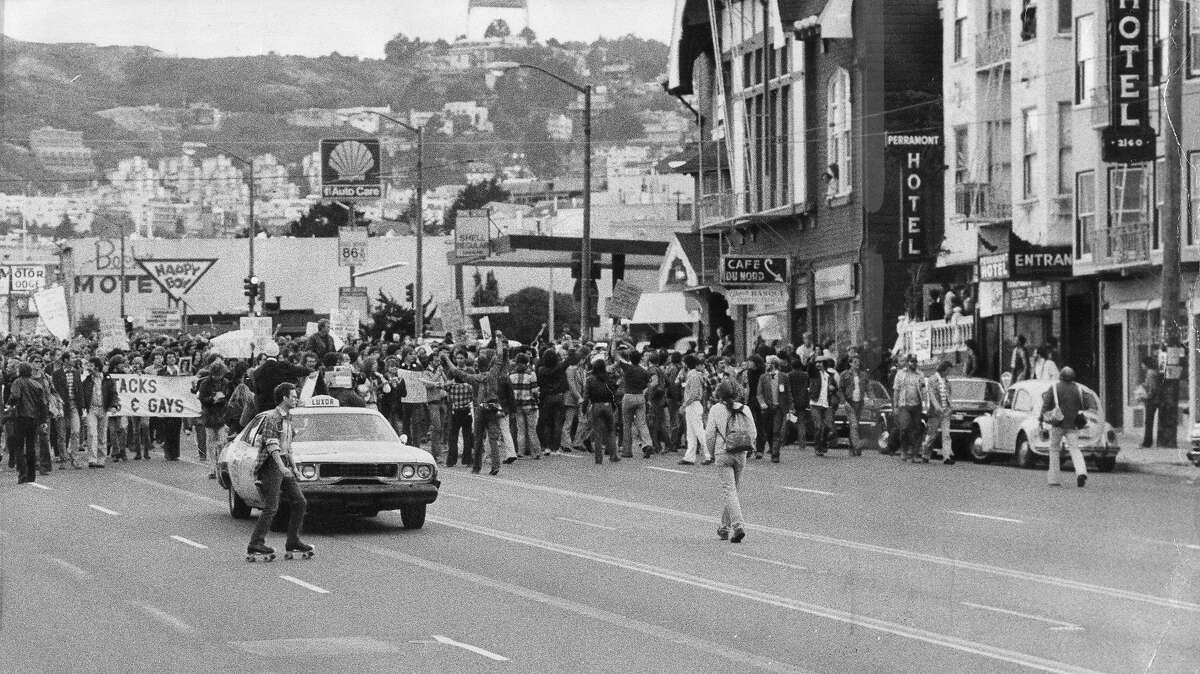 A protest march in reaction to the Dan White manslaughter verdict moves down Upper Market Street, May 21, 1979, P. B