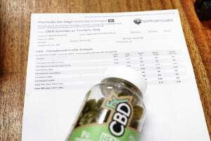 A view of a CBD product with a print out of a third-party testing lab report on the product, seen here at Fallon Wellness Pharmacy on Thursday, May 9, 2019, in Latham, N.Y.    (Paul Buckowski/Times Union)