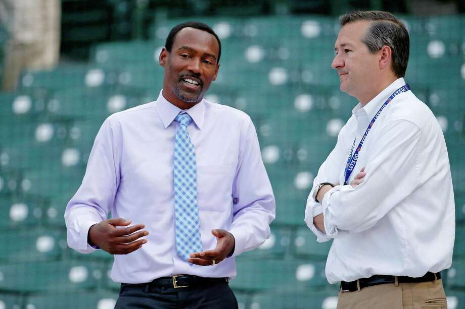 Former Chicago Cubs player and ESPN analyst Doug Glanville, left, talks with Cubs owner Tom Ricketts before a 2016 game at Wrigley Field. Photo: Jon Durr / Getty Images / 2016 Jon Durr 2016 Jon Durr