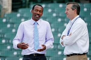 Former Chicago Cubs player and ESPN analyst Doug Glanville, left, talks with Cubs owner Tom Ricketts before a 2016 game at Wrigley Field.