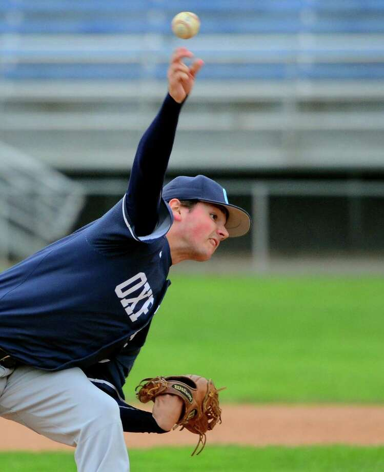 Oxford's Liam Donaldson delivers a pitch during his team's 9-0 win over Ansonia on Thursday. Photo: Christian Abraham / Hearst Connecticut Media / Connecticut Post