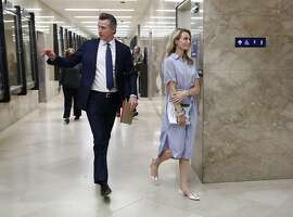 Gov. Gavin Newsom and his wife, First Partner Jennifer Siebel Newsom, return to the Governor's Office after he unveiled his revised 2019-2020 state budget at a news conference Thursday, May 9, 2019, in Sacramento, Calif. Newsom, a Democrat, has proposed a $213.5 billion spending plan. (AP Photo/Rich Pedroncelli)