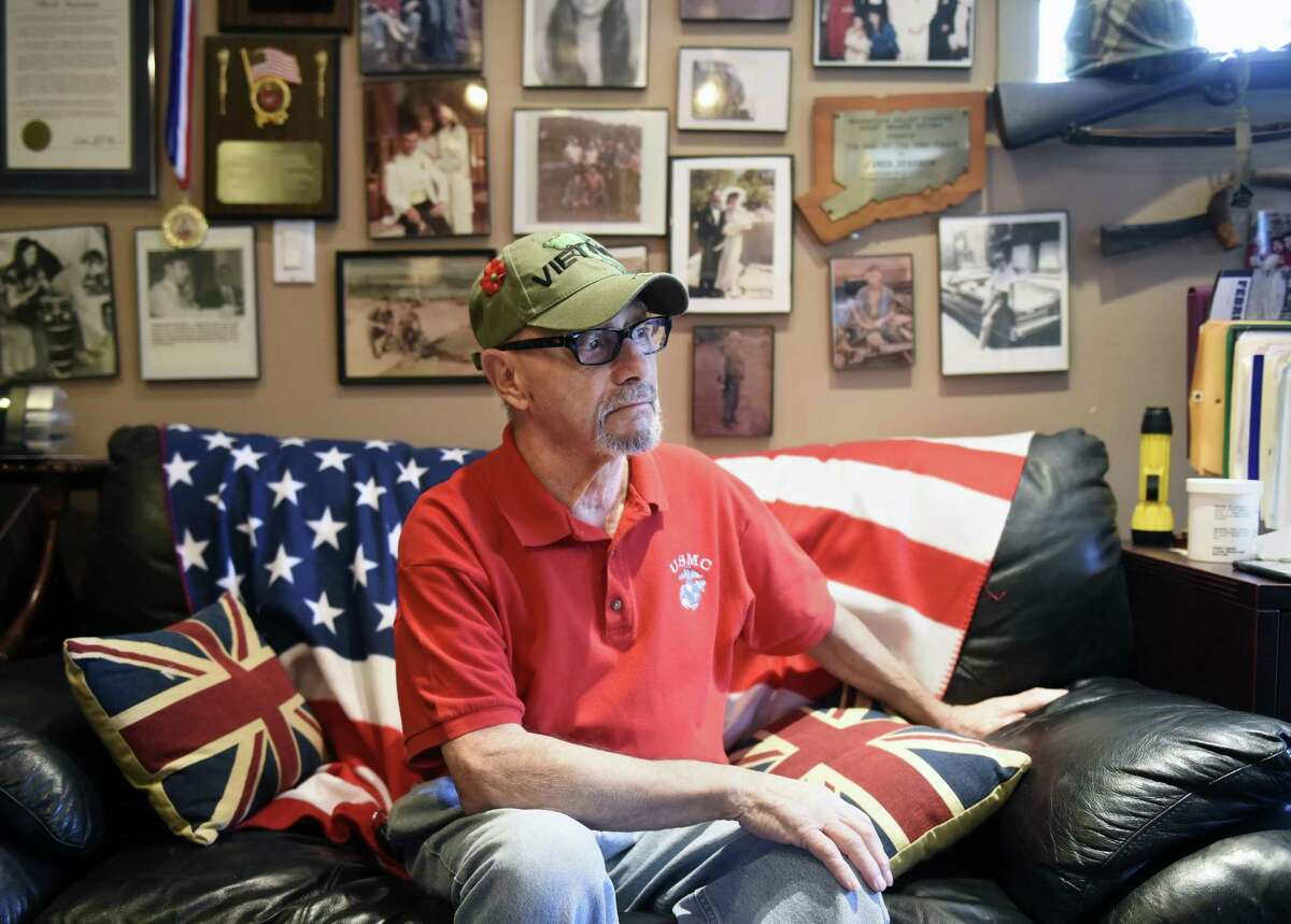 Vietnam veteran Jimmy Sparrow poses at his home in Stamford, Conn. Wednesday, Dec. 5, 2018. Sparrow, a Marine, was mentioned in a speech by President George H.W. Bush when he came to Stamford to stump for then-Governor John Rowland in October of 1990.