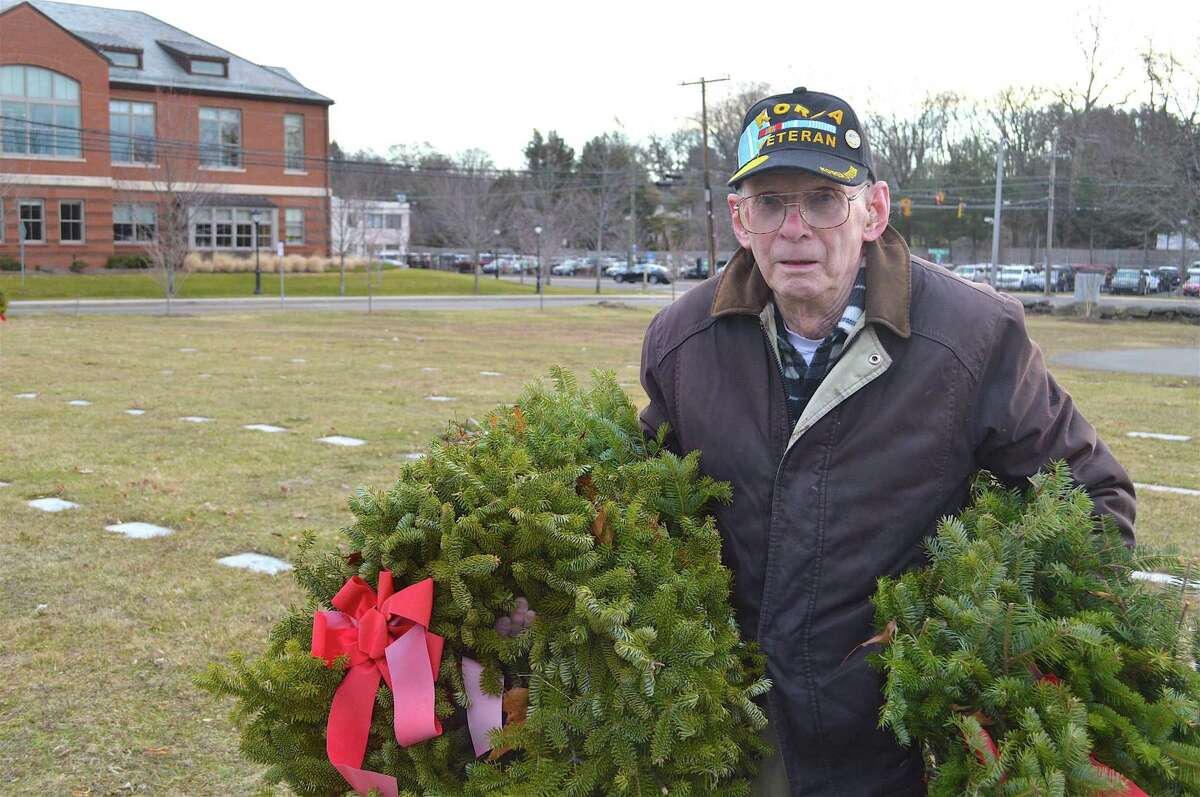 Larry Spann of Stamford, a Korean War veteran, helped collect the 2,184 wreaths at Veterans' Cemetery, Saturday morning, Jan. 28, 2017, in Darien, Conn.