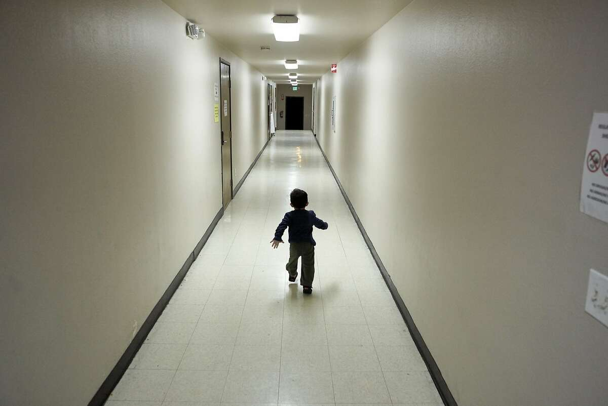 FILE - In this Dec. 11, 2018 file photo, an asylum-seeking boy from Central America runs down a hallway after arriving from an immigration detention center to a shelter in San Diego.
