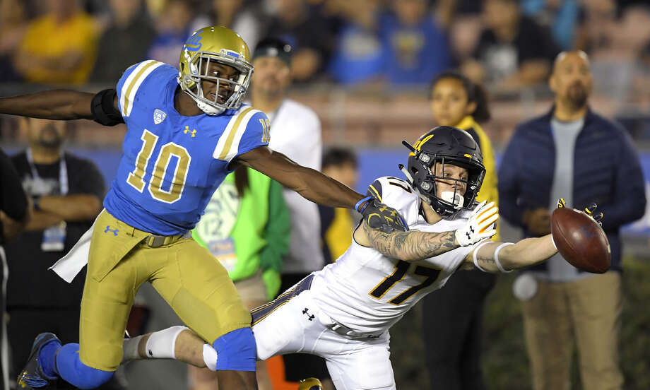 California wide receiver Vic Wharton III, right, can't reach a pass intended for him while under pressure from UCLA defensive back Colin Samuel during the first half of an NCAA college football game, Friday, Nov. 24, 2017, in Los Angeles. (AP Photo/Mark J. Terrill) Photo: Associated Press