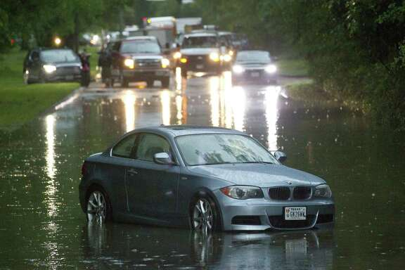 Thunderstorms brought heavy rain that flooded sections of Kingwood Drive near Big Springs Drive, Tuesday, May 7, 2019, in Kingwood.