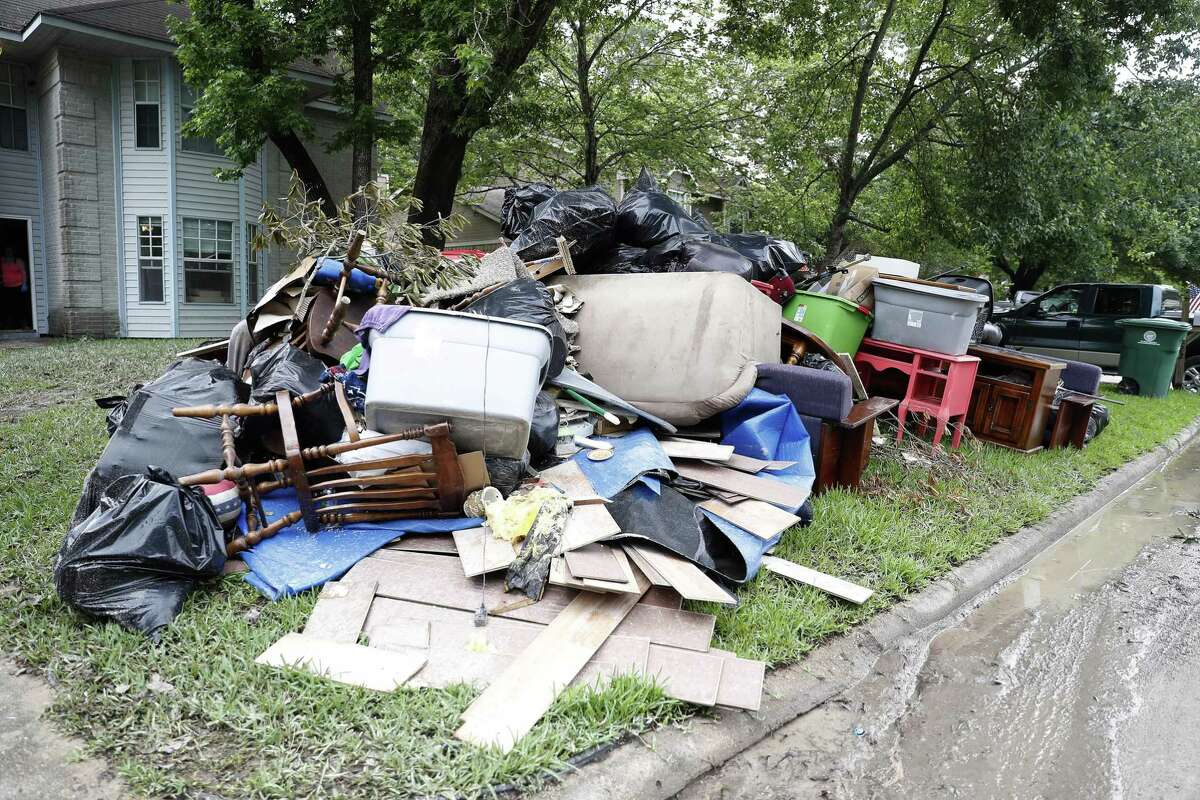 Residents in the Elm Grove subdivision put their flood damaged belongings on the curbs, in Kingwood, Thursday, May 9, 2019, after floodwaters damaged their homes Tuesday and Wednesday.