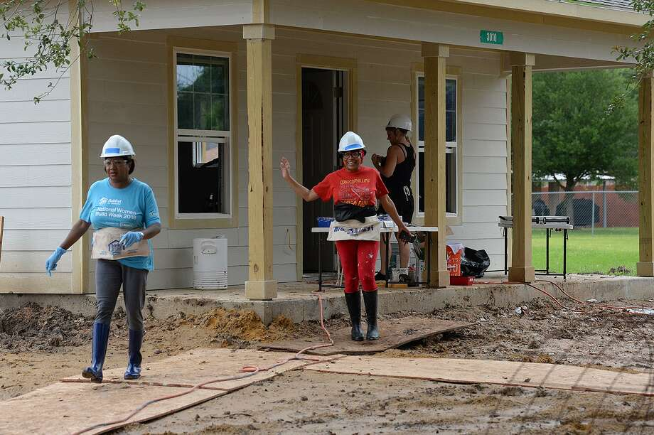 From left Sharon Dogier-Davis and Brook Franklin work Wednesday on a Beaumont home during the Habitat for Humanity's Women's Build event. The event provides a home for a family while raising awareness for female workers and highlighting that women are the main recipients of Habitat homes. Photo taken Wednesday, 5/8/19 Photo: Guiseppe Barranco/The Enterprise, Photo Editor / Guiseppe Barranco ©