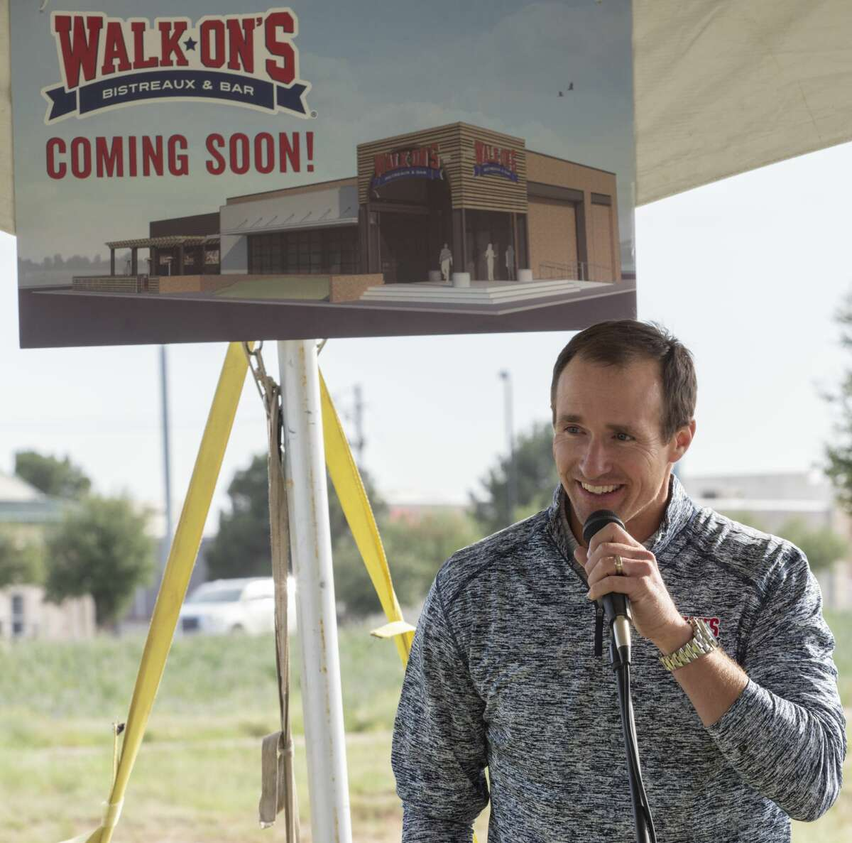 Drew Brees, co-owner of Walk*Ons Bistreaux Bar, and quarterback for the New Orleans Saints, helps with the announcement 05/09/19 of a new location off Loop 250 and Whitman Drive. Tim Fischer/Reporter-Telegram