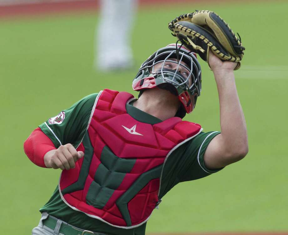 The Woodlands catcher Drew Romo (23) fields a fly ball by Dalton Bourgeois #6 of Cypress Woods in the fifth inning of Game 2 during a Region II-6A area high school baseball playoff series at Grand Oaks High School, Thursday, May 9, 2019, in Spring. Photo: Jason Fochtman, Houston Chronicle / Staff Photographer / © 2019 Houston Chronicle