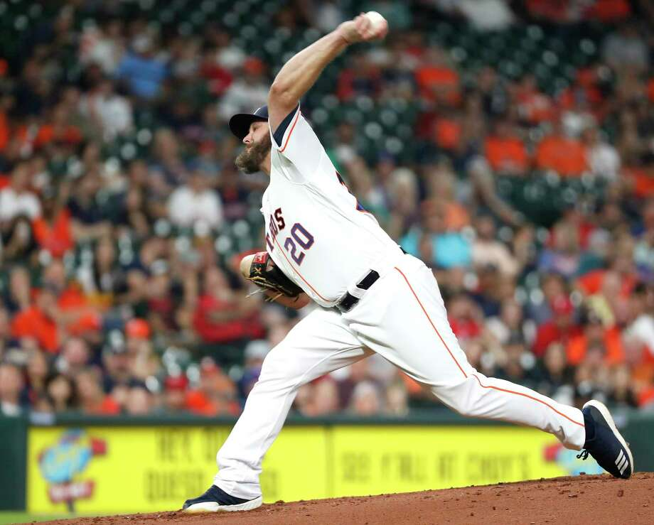 Astros starting pitcher Wade Miley (20) throws a strikeout pitch to the Rangers' Joey Gallo for his 1,000th career strikeout during the second inning Thursday at Minute Maid Park. Photo: Brett Coomer, Staff Photographer / © 2019 Houston Chronicle