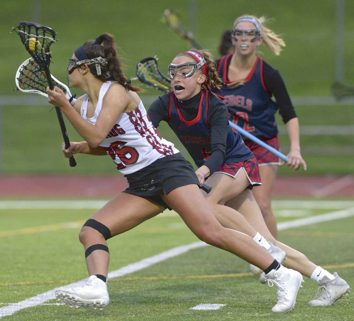 Pomperaug's Camden Frissora (26) tries to go around New Fairfield's Jordan Siemonson (4) in the girls lacrosse game between New Fairfield and Pomperaug high schools, Thursday, May 9, 2019, at Pomperaug High School, Southbury, Conn.