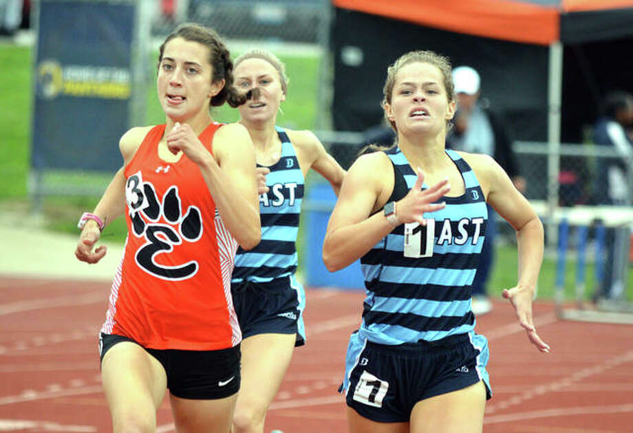 Edwardsville's Maddie Miller, left, competes in the 800-meter run on Thursday at the Class 3A O'Fallon Sectional. Miller qualified for the state meet by placing second with a personal-record time of 2:20.24. Edwardsville's Abby Korak, middle, competes in the 1,600-meter run during Thursday's Class 3A O'Fallon Sectional. Korak won the race with a program-record time of 5:04.83 Photo: Scott Marion/The Intelligencer