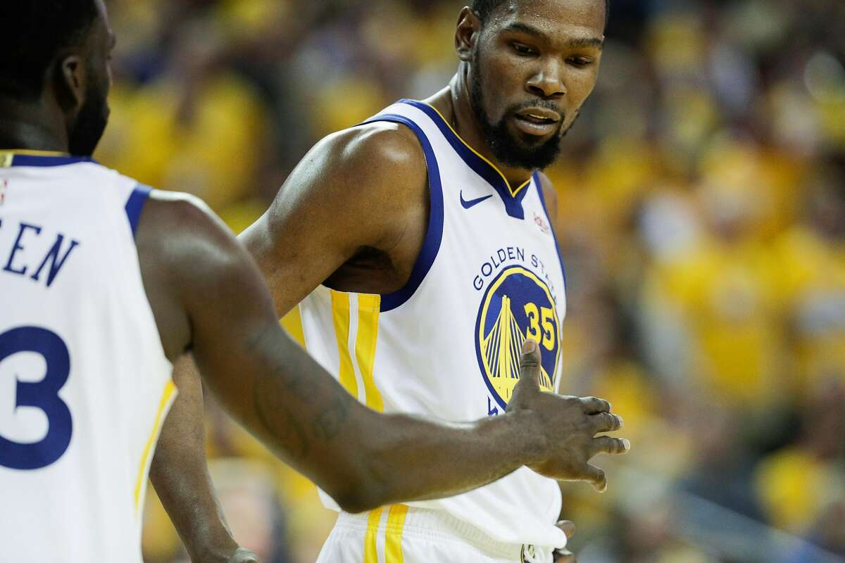 Golden State Warriors Kevin Durant and Draymond Greenhigh five in the third quarter during game 5 of the Western Conference Semifinals between the Golden State Warriors and the Houston Rockets at Oracle Arena on Wednesday, May 8, 2019 in Oakland, Calif.