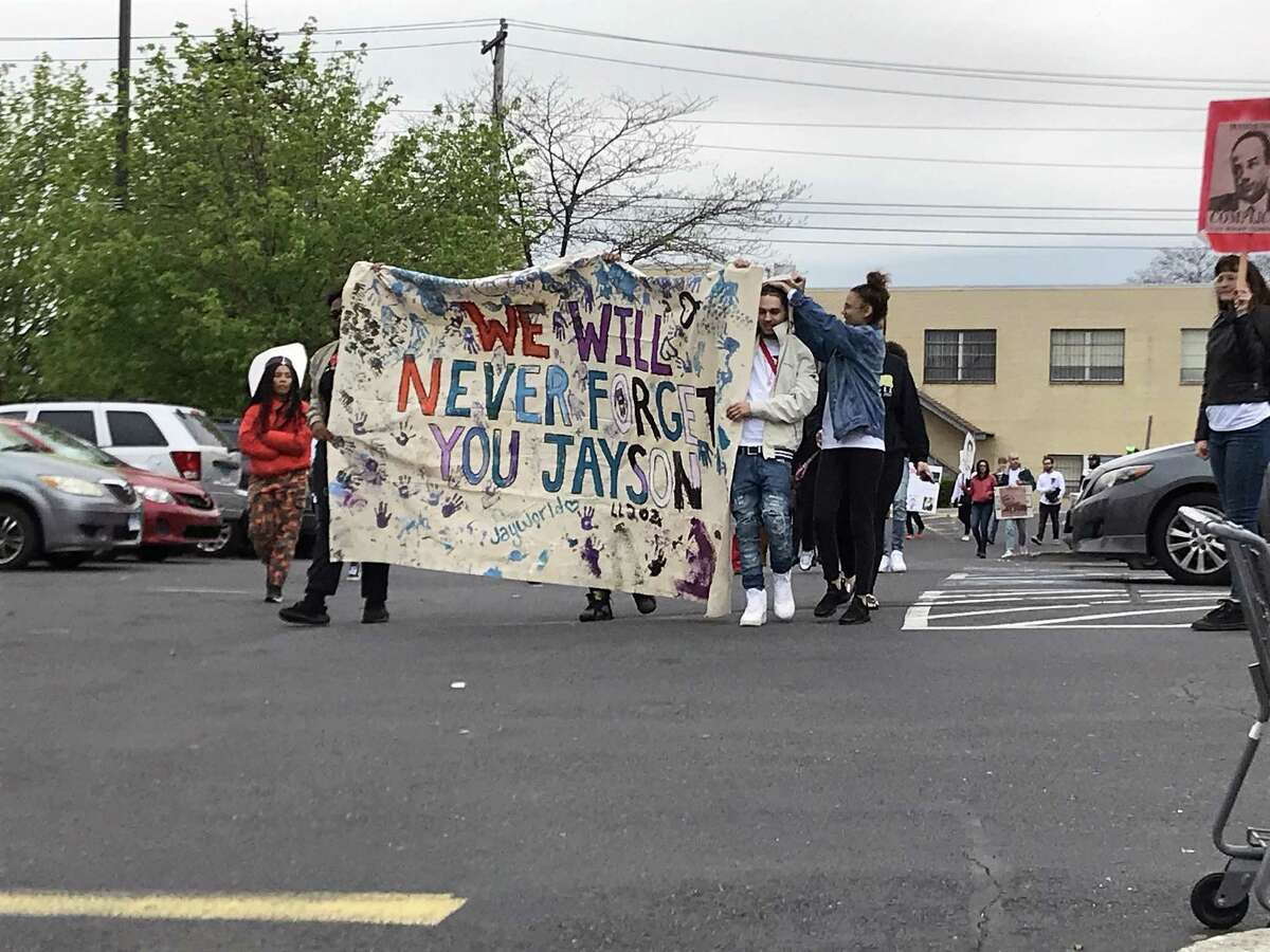 Friends and family walking through the parking lot of Walgreens, 1000 Park Ave. in Bridgeport, Conn., on May 9, 2019. They gathered to remember 15-year-old Jayson Negron, fatally shot by a Bridgeport police officer two years ago on May 9, 2017.