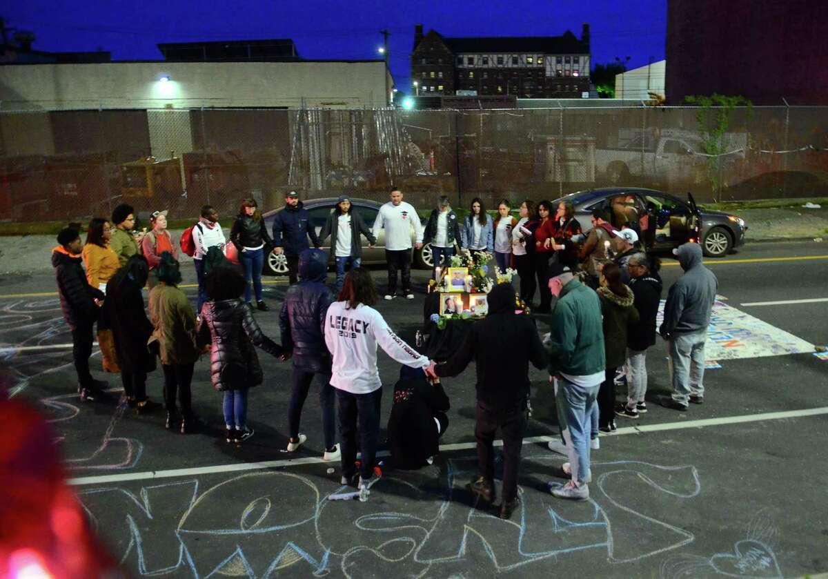 Activists and friends of Jayson Negron hold a vigil along Fairfield Ave in Bridgeport, Conn., on Thursday May 9, 2019. They were there to mark the second anniversary of Negron's death after he was shot and killed by a police officer.