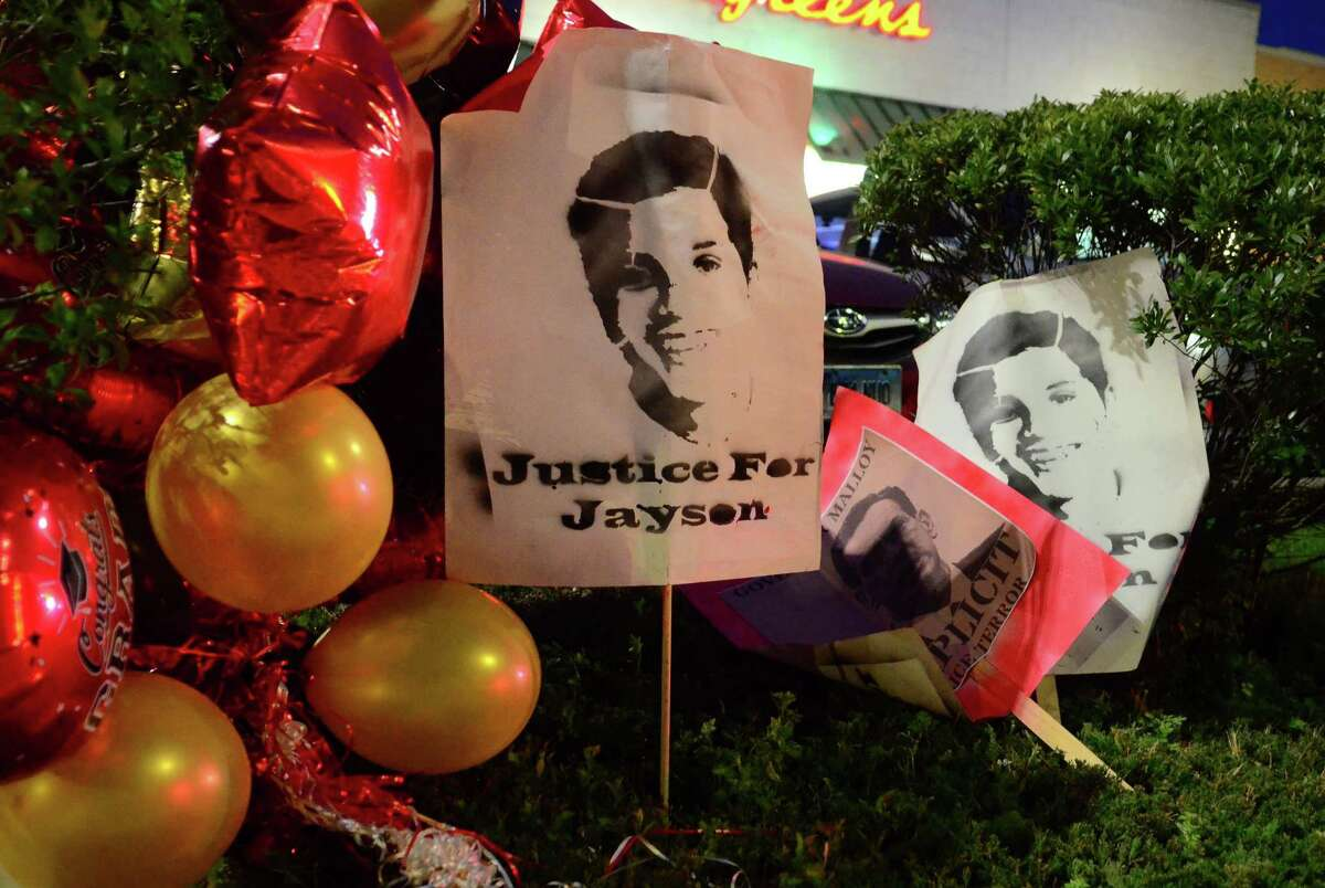 Posters with Jayson Negron's picture are placed near where activists and friends hold a vigil for him near the parking lot of the Walgreen's along Fairfield Ave in Bridgeport, Conn., on Thursday May 9, 2019. They were there to mark the second anniversary of Negron's death after he was shot and killed by a police officer near the pharmacy.