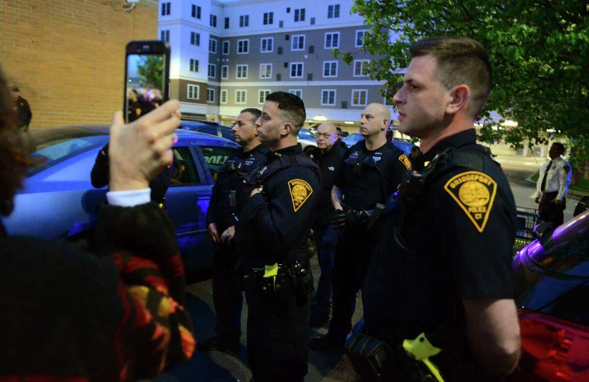 A heavy police presence was on hand as activists and friends of Jayson Negron hold a vigil near the Walgreen's along Fairfield Ave in Bridgeport, Conn., on Thursday May 9, 2019. They were there to mark the second anniversary of Negron's death after he was shot and killed by a police officer near the pharmacy.