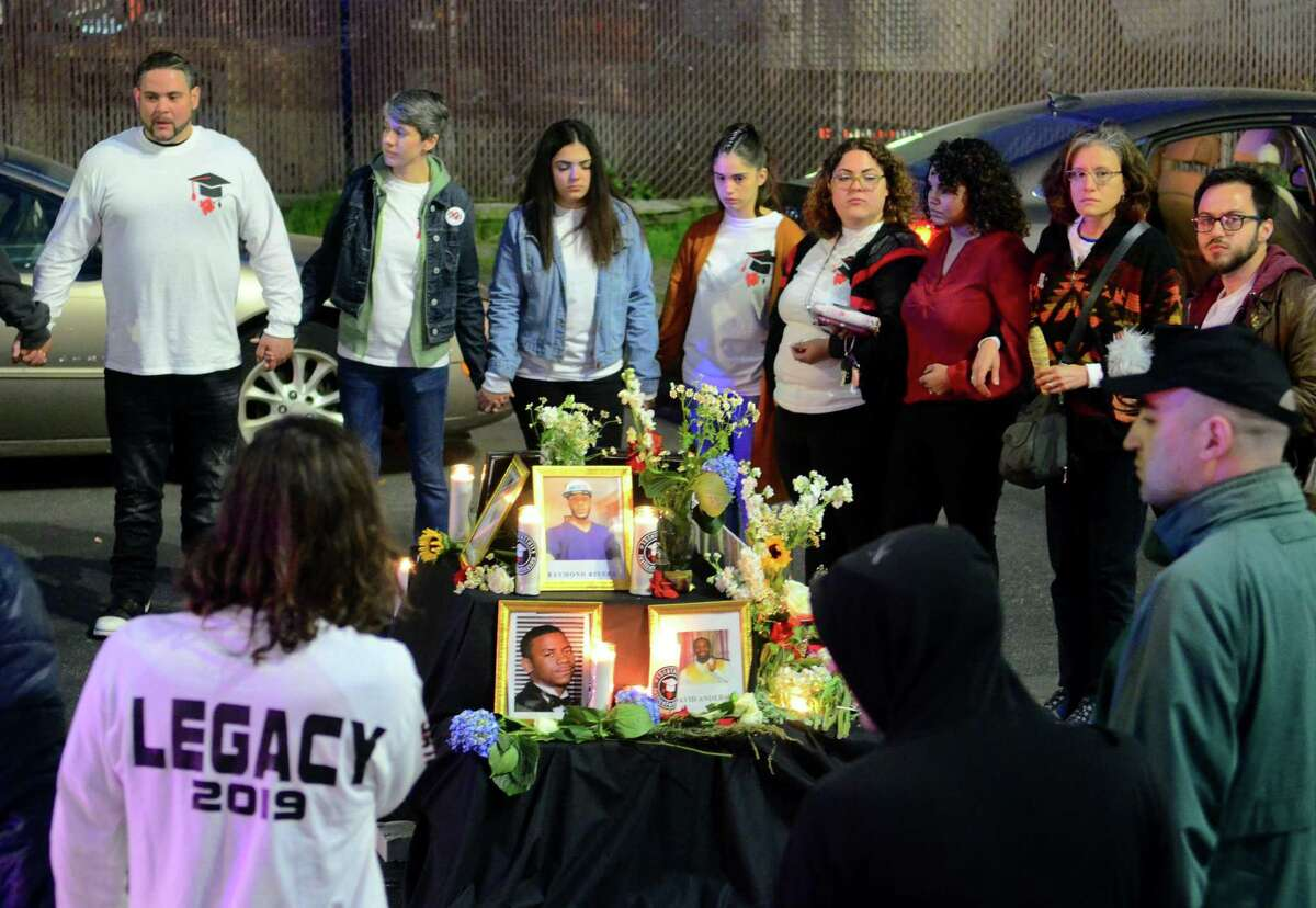 Activists and friends of Jayson Negron hold a vigil near the Walgreen's along Fairfield Ave in Bridgeport, Conn., on Thursday May 9, 2019. They were there to mark the second anniversary of Negron's death after he was shot and killed by a police officer near the pharmacy.
