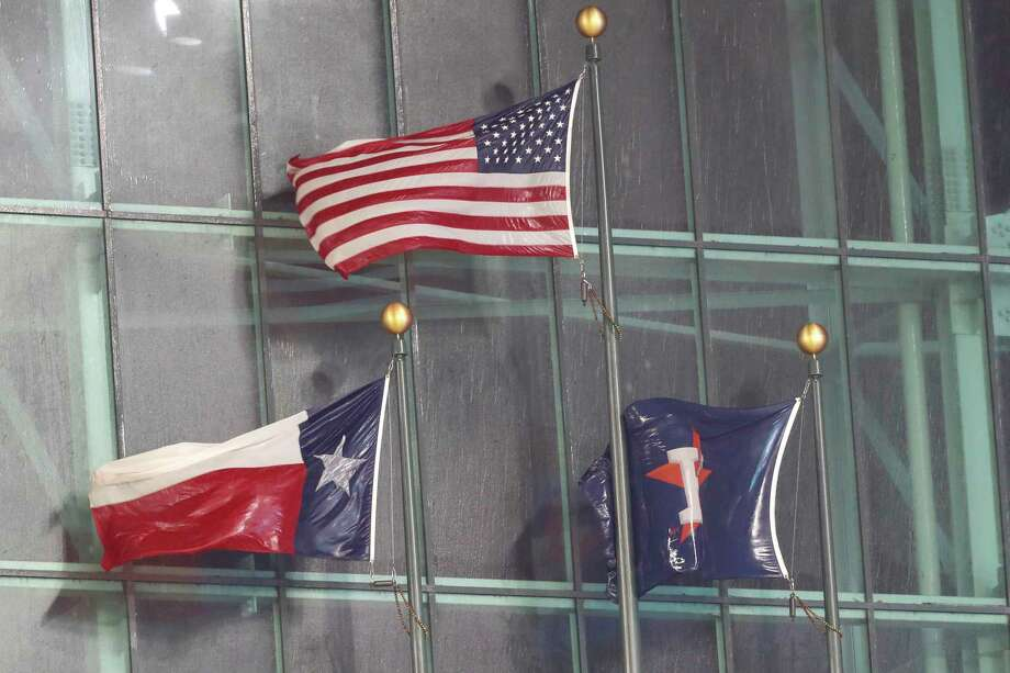 Rain-soaked flags fly under the closed roof as the heavy rain leaks into Minute Maid Park during the eighth inning in a major league baseball game between the Houston Astros and Texas Rangers on Thursday, May 9, 2019, in Houston. Photo: Brett Coomer, Staff Photographer / © 2019 Houston Chronicle