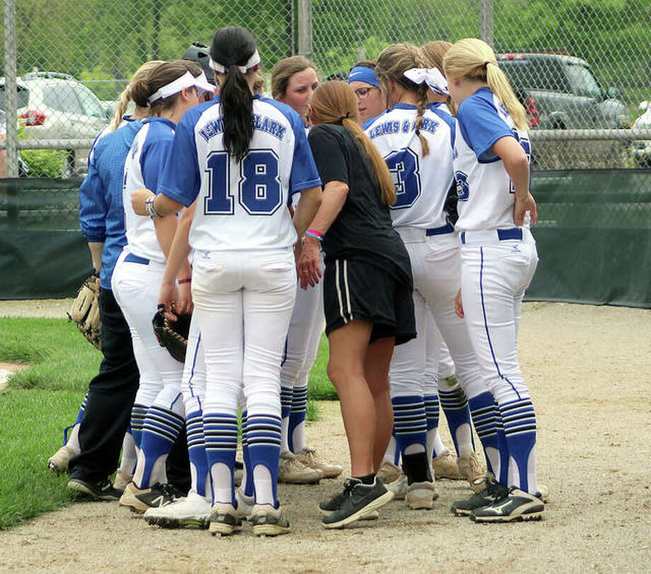 The Lewis and Clark softball team, shown huddling with coach Ronda Roberts during a recent game, will face Heartland Community College Friday in the first round of the NJCAA Division II Region 24 Softball Tournament in Mattoon.
