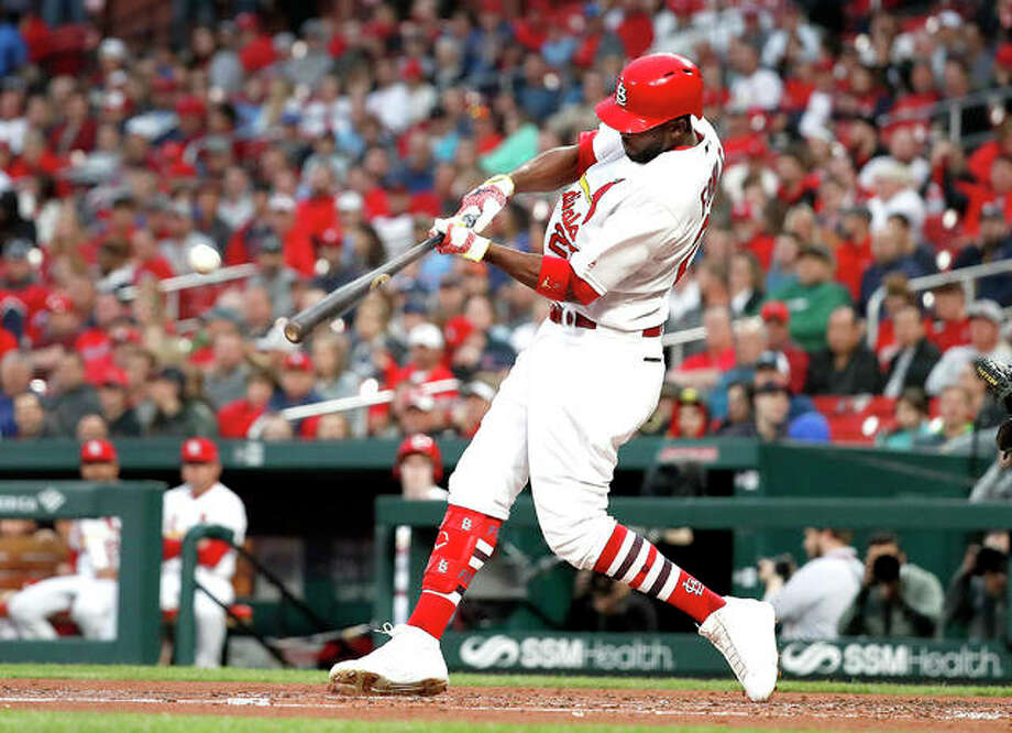 The Cardinals' Dexter Fowler hits a ground-rule double to score two runs in the second inning of Monday night's victory over the Pittsburgh Pirates at Busch Stadium. Photo: AP Photo