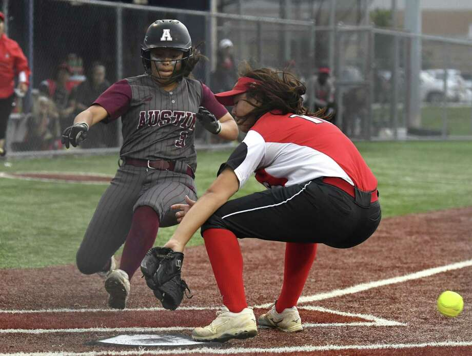 Judson pitcher Emily Ayala can't hold on to the ball as Austin High's Lexie Aleman scores in the third. Aleman also got across in the seventh on Alyssa Ybarra's bases-loaded double. Photo: Billy Calzada /Staff Photographer / Billy Calzada