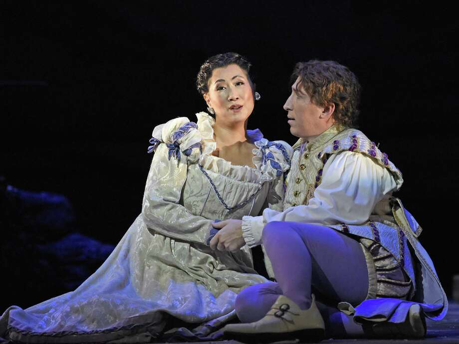 """Soprano Yunah Lee, from left, and tenor Joshua Dennis play Marguerite and the title character, respectively, in Opera San Antonio's production of """"Faust."""" Photo: Karen Almond / Karen Almond"""