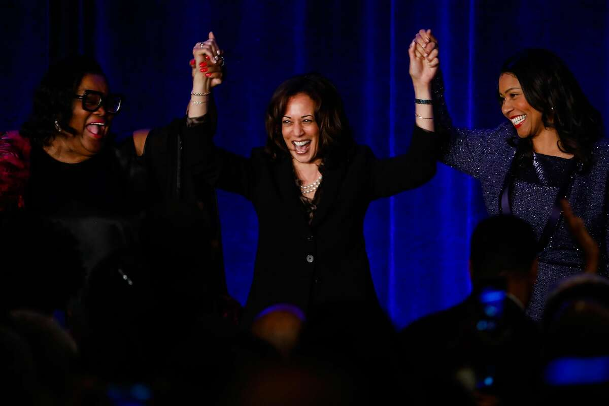 Democratic Presidential candidate U.S. Sen. Kamala Harris (center) raises her arms with Mayor London Breed (right) and San Francisco Sun Reporter publisher Amelia Ashley-Ward (left) as they celebrate the Sun-Reporter's anniversary gala which celebrated 75 years as the city's black weekly publication at the Hyatt Regency in San Francisco, California, on Thursday, May 9, 2019.