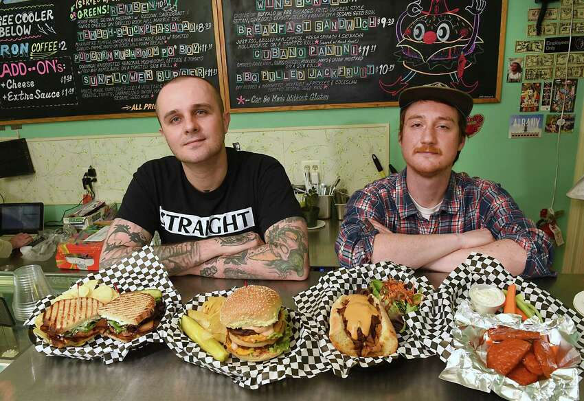 Owners Joey Berben, left, and Max Wolff stand with some of their vegan food, from left, BLT, big Max burger, Philly Cheesesteak sandwhich, and Buffalo wings at Berben & Wolff's Delicatessen on Wednesday, May 8, 2019 in Albany, N.Y. (Lori Van Buren/Times Union)