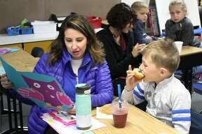 """Mothers and their little ones gathered at Bad Axe Elementary on Friday for a special, tasty treat. """"Muffins with Mom"""" was an early opportunity to celebrate Mother's Day."""