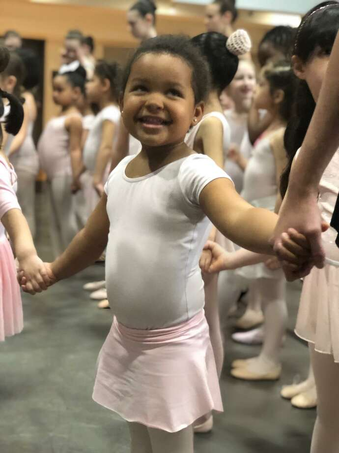 A young dancer smiles during rehearsals at New Haven Ballet. Photo: New Haven Ballet / Contributed Photo