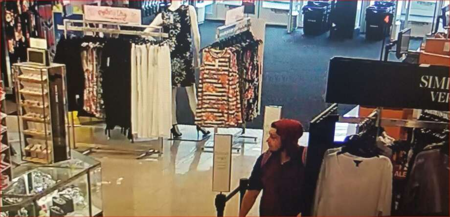 The New Milford Police Department is asking the public to help identify this man, suspected of shoplifting bluetooth speakers from the Kohl's store in New Milford. Photo: New Milford Police Department / New Milford Police Department