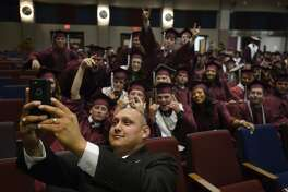 Paul Trevino, principal of Silsbee High School, takes a photo with graduating seniors before their graduation, Friday, May 26, 2017. Photo taken Friday 5/26/17 Ryan Pelham/The Enterprise