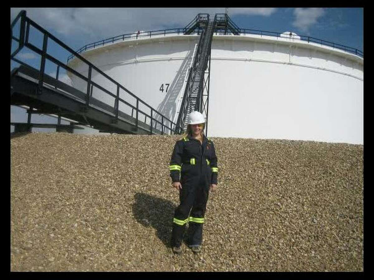 Marnie Yohemas, shown early in her career in front of Enbridge's tank farm. Yohemas grew up in the pipeline industry at her family's mid-size oil and gas pipeline business in Canada.
