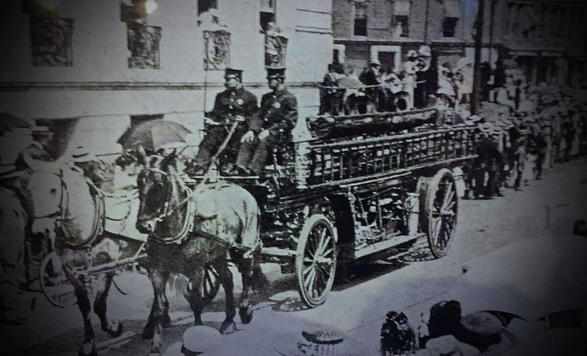 The South End Hook and Ladder truck during the 19012 Memorial Day Parade in Stamford. The image is part of an exhibit on the city's fire department at the Stamford Historical Society.