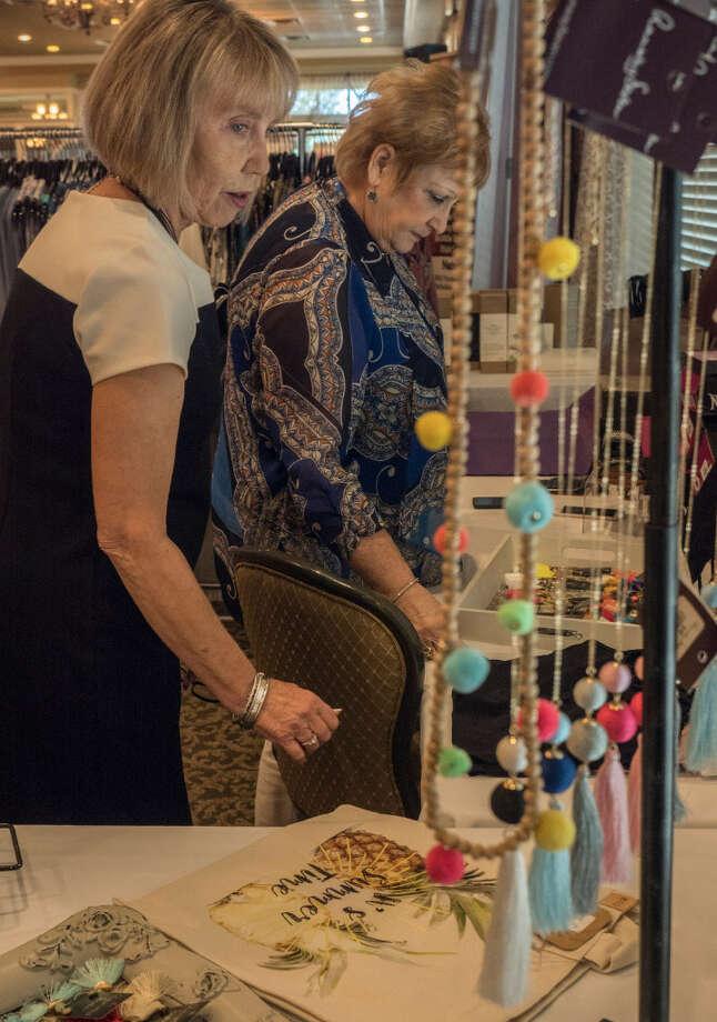 Guests shop through goods at the spring fundraiser Lookbook Brunch. Photo: Tim Fischer/Reporter-Telegram