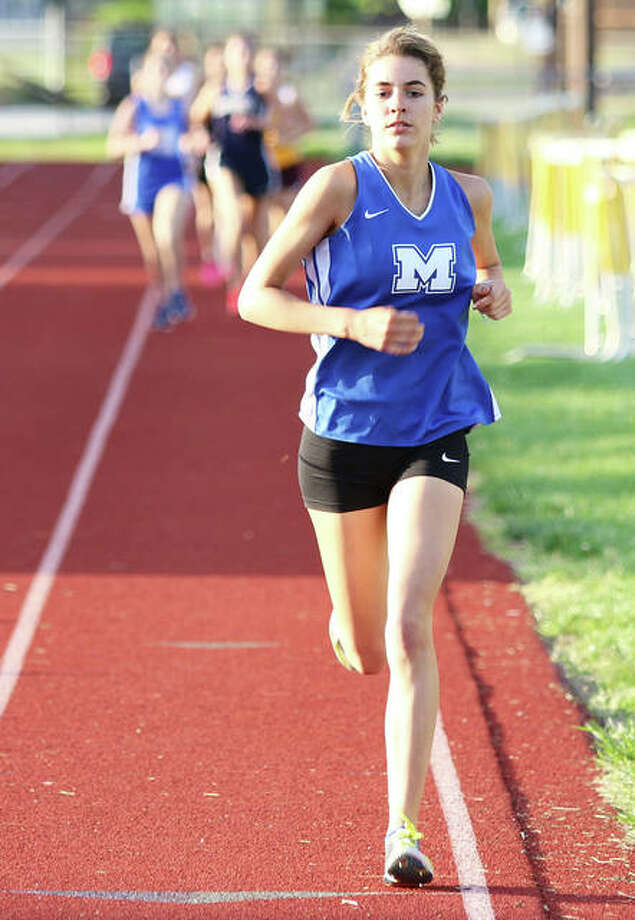 Marquette Catholic's Riley Vickrey, shown drawing off from the field in meet earlier this season, ran to victories in both the 1,600 and 3,200 on Thursday to lead the Explorers to their first team postseason championship at the Carlinville Class 1A Sectional. Photo: Greg Shashack / The Telegraph