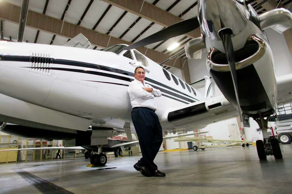 Aviation magnate Adam Katz with one of his jets in Farmingdale, N.Y., on Jan. 12, 2012. (Chang W. Lee/The New York Times)