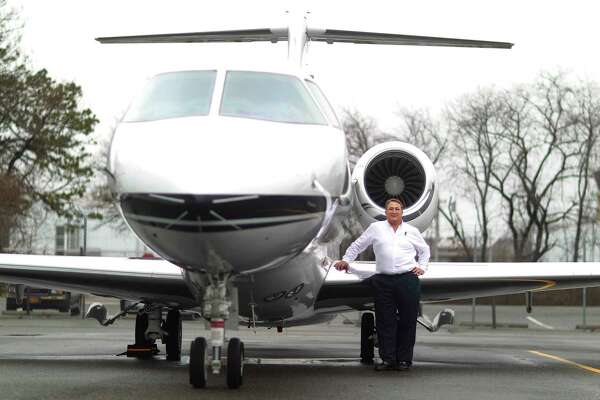 Adam Katz, who owns and runs Talon Air, a charter flight company on Long Island, with one of his jets in Farmingdale, N.Y., Jan. 12, 2012. Although wealthy people tend to favor the Republican Party, 1 percenters expressed a broad range of views on how to fix the economy. (Chang W. Lee/The New York Times)