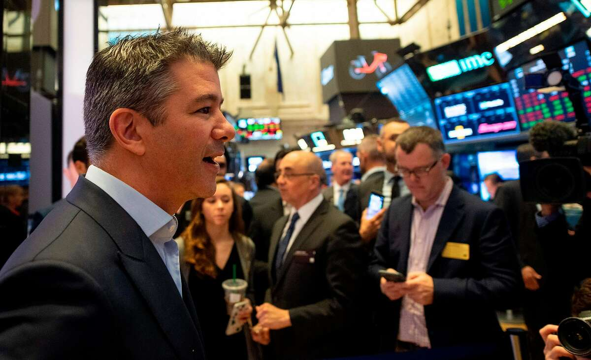 CORRECTION - Uber Co-Founder, Travis Kalanick (L), walks the floor during the IPO of the ride sharing company Uber, at the New York Stock Exchange (NYSE) on May 10, 2019, in New York. (Photo by Johannes EISELE / AFP) / The erroneous mention[s] appearing in the metadata of this photo by Johannes EISELE has been modified in AFP systems in the following manner: [Uber Co-Founder, Travis Kalanick (L),] instead of [Uber Co-Founder, Garrett Camp (L)]. Please immediately remove the erroneous mention[s] from all your online services and delete it (them) from your servers. If you have been authorized by AFP to distribute it (them) to third parties, please ensure that the same actions are carried out by them. Failure to promptly comply with these instructions will entail liability on your part for any continued or post notification usage. Therefore we thank you very much for all your attention and prompt action. We are sorry for the inconvenience this notification may cause and remain at your disposal for any further information you may require.JOHANNES EISELE/AFP/Getty Images
