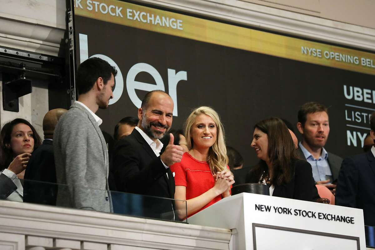 NEW YORK, NEW YORK - MAY 10: Uber CEO Dara Khosrowshahi (center) joins other employees in ringing the Opening Bell at the New York Stock Exchange (NYSE) as the ride-hailing company Uber makes its highly anticipated initial public offering (IPO) on May 10, 2019 in New York City. Uber will start trading on the New York Stock Exchange after raising $8.1 billion in the biggest U.S. IPO in five years.Thousands of Uber and other app based drivers protested around the country on Wednesday to demand better pay and working conditions including sick leave, overtime and a minimum wage. (Photo by Spencer Platt/Getty Images)