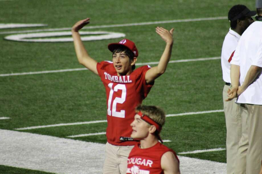 Samuel Matthew Lopez attempts to get the crowd into the game during a Tomball High School football game. Lopez was the Tomball football manager for four years. Photo: Tomball ISD