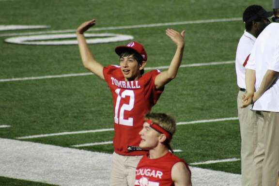 Samuel Matthew Lopez attempts to get the crowd into the game during a Tomball High School football game. Lopez was the Tomball football manager for four years.